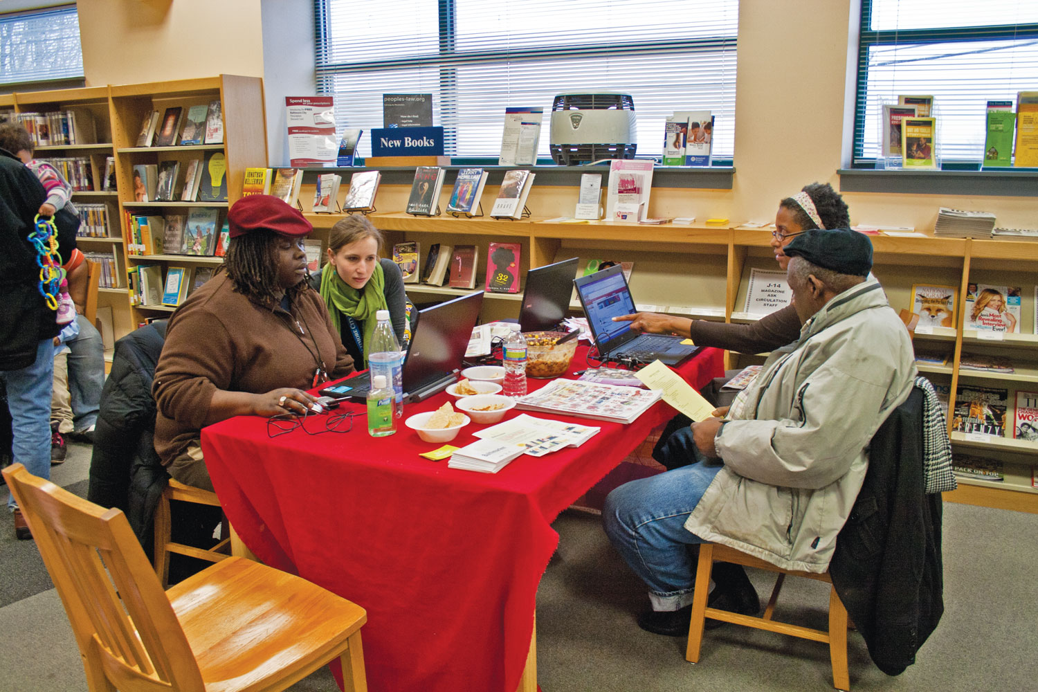 Customers placing orders at library